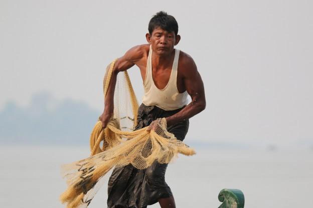 Myanmar 21-019 Fisherman casting a traditional fishing netc Credit P Bates
