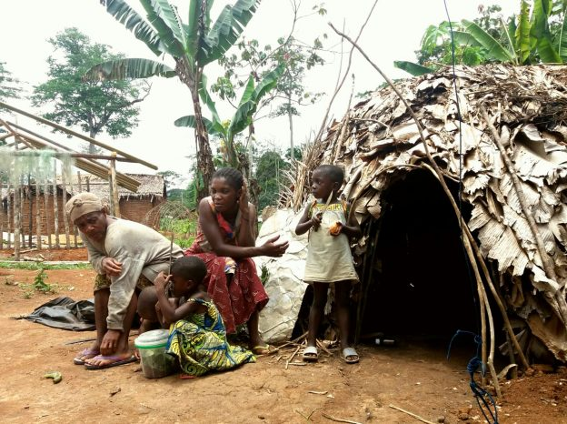 Cameroon 24-029 Baka women and children outside traditional hut, Credit - Eva Avila
