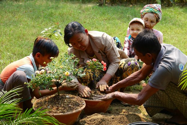 Myanmar 21-012 7b Destination Ayeyarwady 3 generations attending Hsithe garden, Credit - Paul Bates