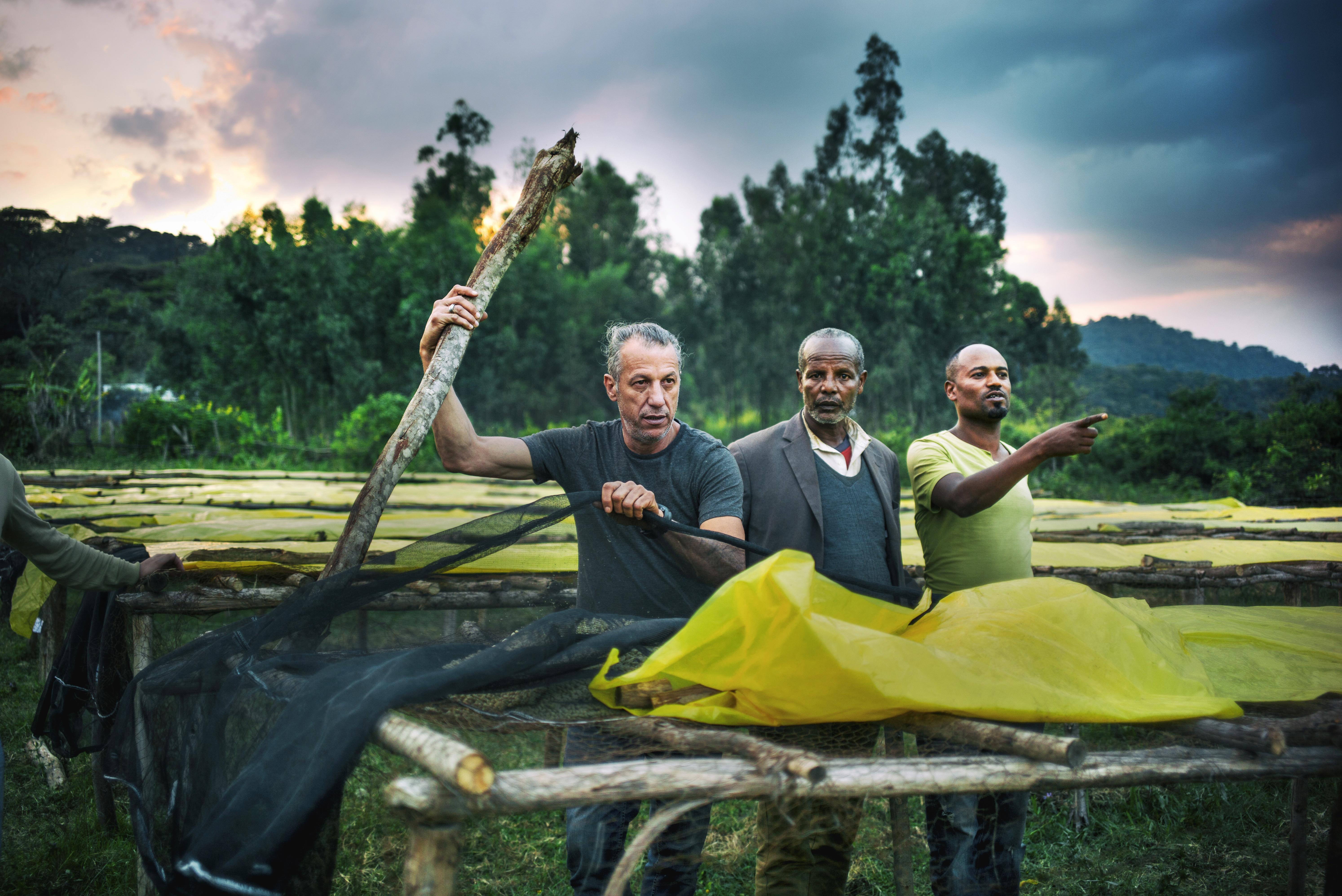Ethiopia 22-006, Graciano Cruz, a coffee farmer from Panama, advises on drying bed construction, Credit - Emily Garthwaite.jpg