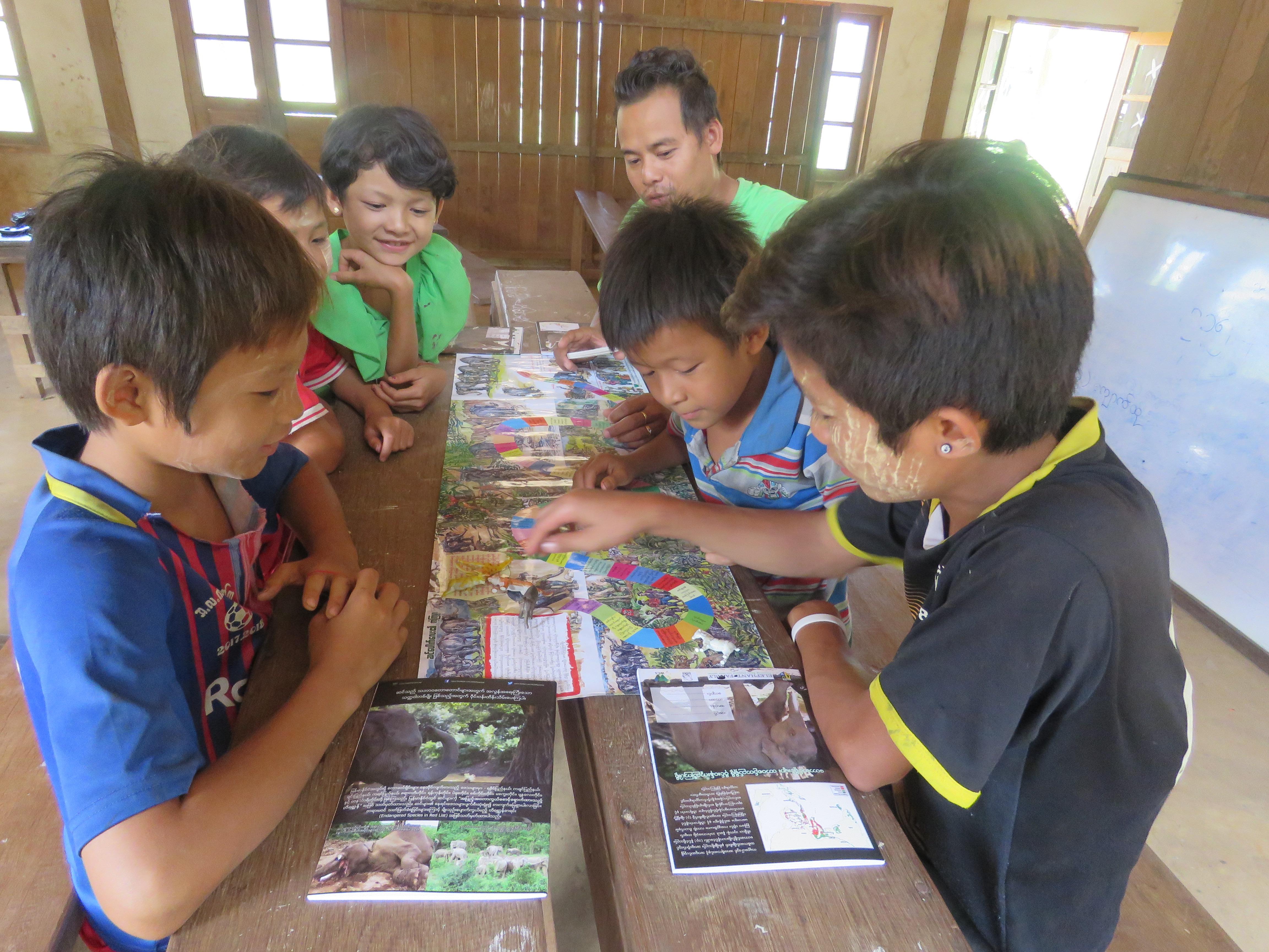 Burma 24-024 Children playing the WCS educational elephant board game, Credit WCS-Myanmar