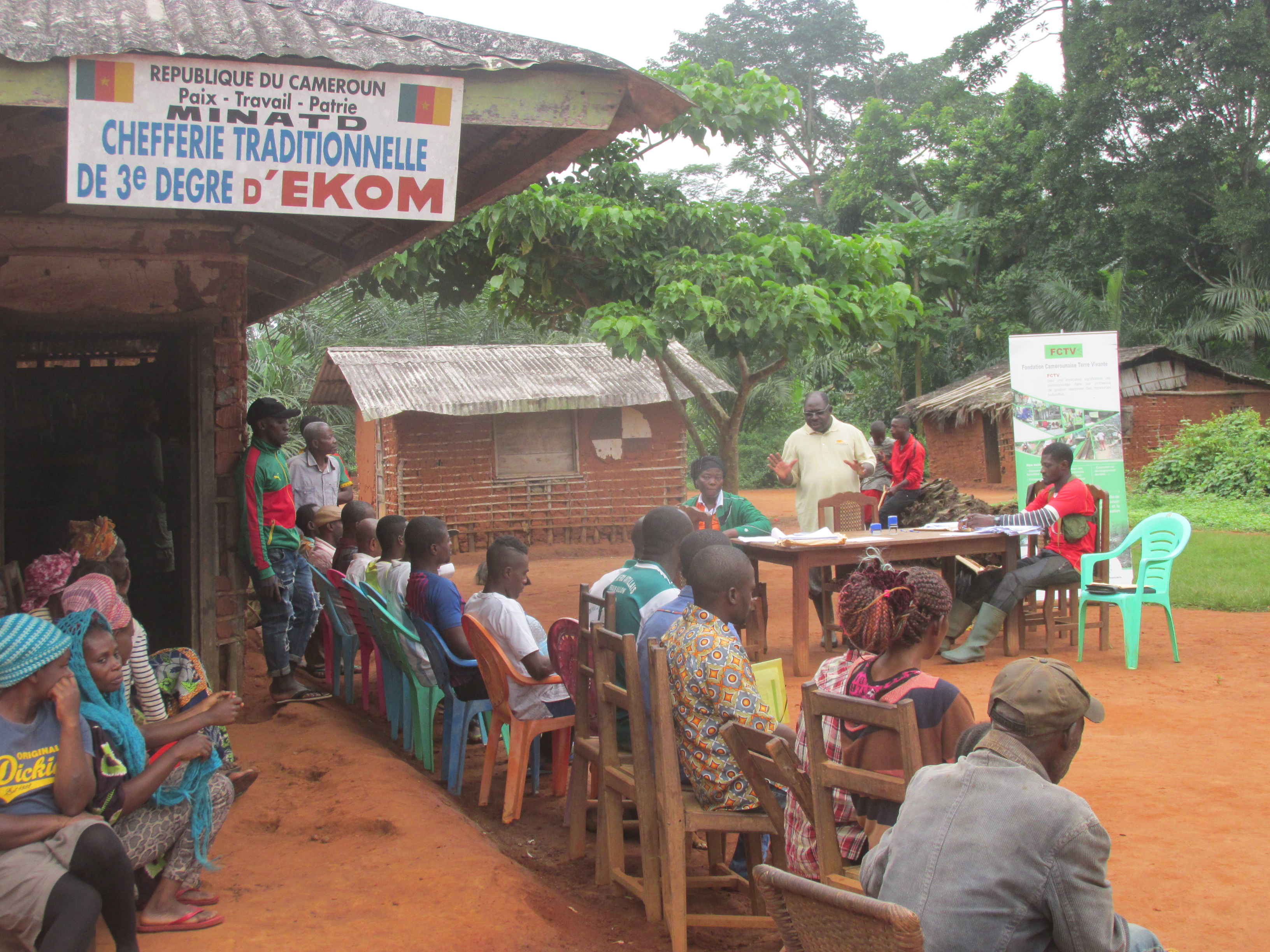 Cameroon 24-005 Manfred Epanda introducing format to villagers, Credit - FCTV